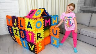 Ulya builds colored Playhouse with Alphabet blocks