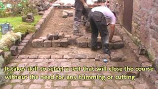 Laying gritstone setts