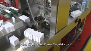 Automatic group packaging machine of cardboard boxes with tablets in cellophane