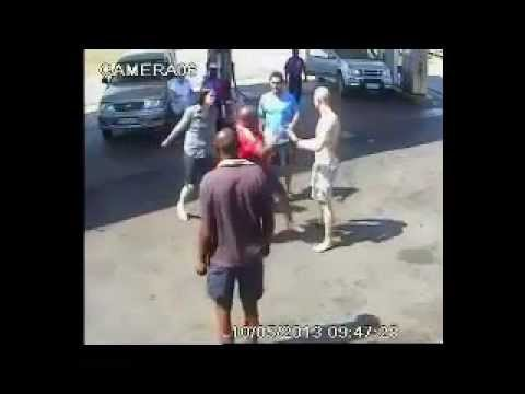 2 vs 1 at a fuel station in South Africa. One guy goes down hard. Evidently the guy in the red shirt didn't appreciate the way he was told to move his vehicle that was parked in the entrance......
