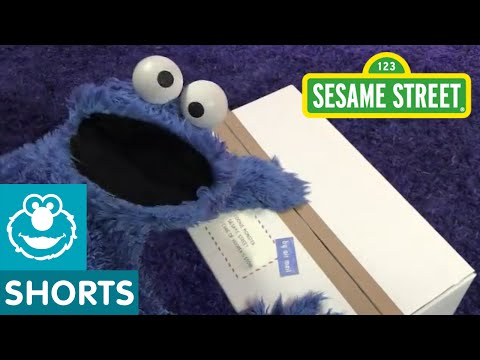 Sesame Street: Cookie Monster Unboxing a Package from the UK