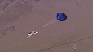 Powerless plane makes parachute landing