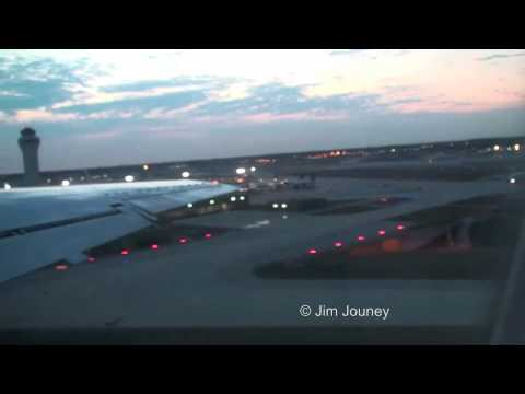 Continental Express Embraer E-145 departing Detroit Metro Airport when is was swarming with NWA red tails - Clip includes engine start-up, taxi and a dusk ta...