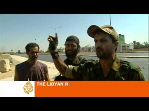 Rebels fight for Gaddafi-held neighbourhood