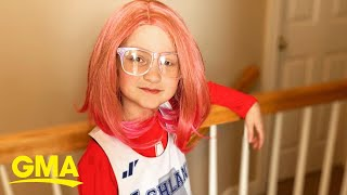 Meet the little girl who inspires a small town to wear pink wigs each year