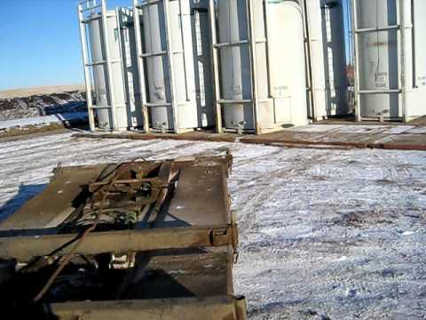 Texas Bed Raising A Tank Farm - Alberta Oilfield