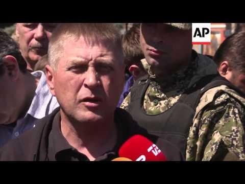"Self-declared Slovyansk mayor accuses OSCE delegation of being ""spies;"" funeral"