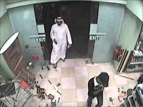 Bahrain- Armed regime loyalist thugs burgles Shia businesses 19_05_2011