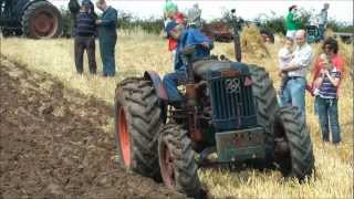 Vintage Fordson 4WD tractor ploughing