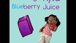 Feeding Kyla Blueberry Juice