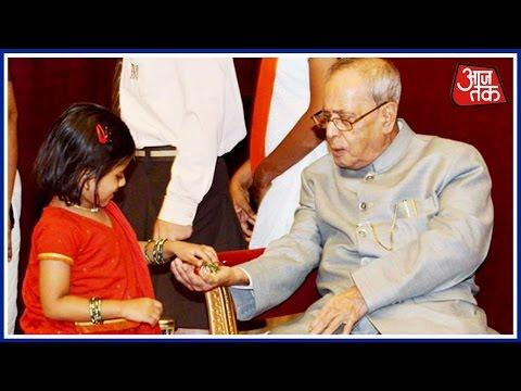 School Kids Tie Rakhi On The Hands Of President Pranab Mukherjee On The Occasion Of Raksha Bandhan