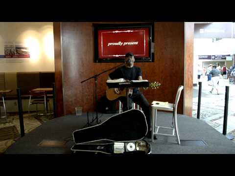 Joe West performing in the Nashville International Airport