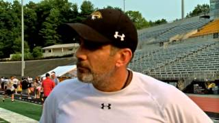 Towson Football's Offensive Line Coach John Donatelli talks with TSN after practice