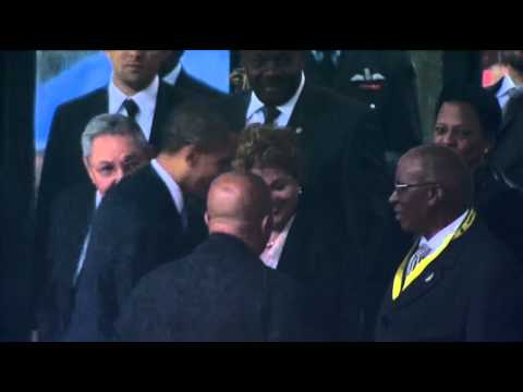 Raw: Obama and Castro Shake Hands at Service