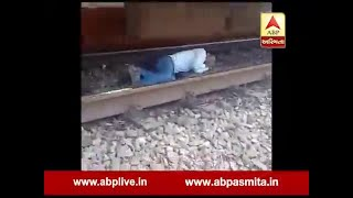 Young man sleep under the railway track while train came, video viral