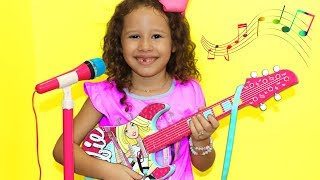 Valentina Plays with Disney Barbie Toy Guitar and Starts a Band