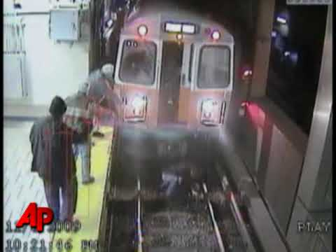 Raw Video: Woman Fell in Front of Oncoming Train