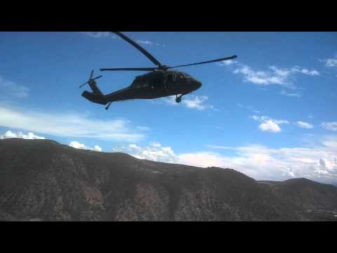 Colorado National Guard UH-60 Black Hawk Helicopter Rescues Injured Paraglider. More military videos at http://www.youtube.com/user/okrajoe Colo. National Gu...