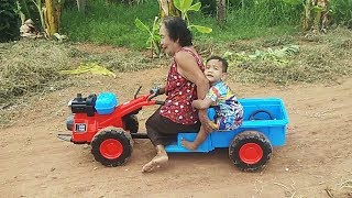 Granmother Rides On Boy's Toy Truck