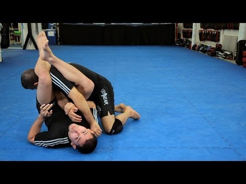 Arm Bar from Guard against Punches | MMA Submissions Image 1