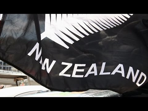 Open top vintage retro car, black New Zealand flag, wind. Stock Footage