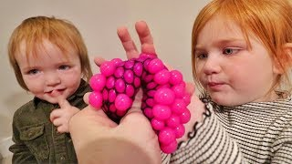 WEiRD TRiCK SHOTS with the FAMILY!!  Niko & Adley learn a fun new ball game and a surprise for mom!