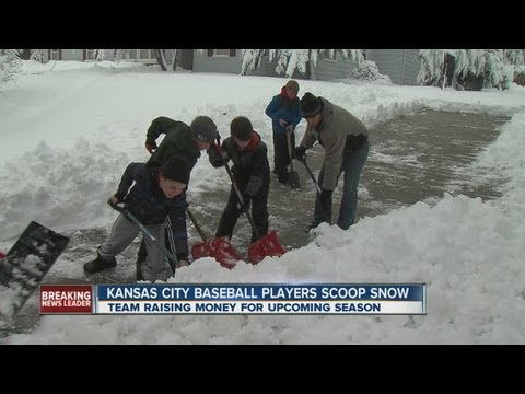 Young baseball players help dig out neighborhood