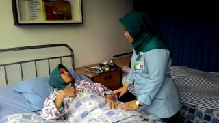 GIVING INJECTION ( NURSE STUDENT FROM STIKES PERTAMEDIKA)