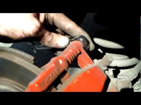 how to replace the rear brake pads on a 2007 toyota corolla verso