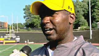 Towson Football's Running Backs Coach Dassin Blackwell talks with TSN after practice