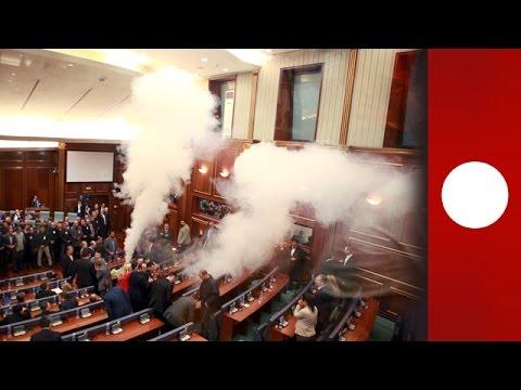 Kosovo parliament scuffles: opposition use tear gas & pepper spray