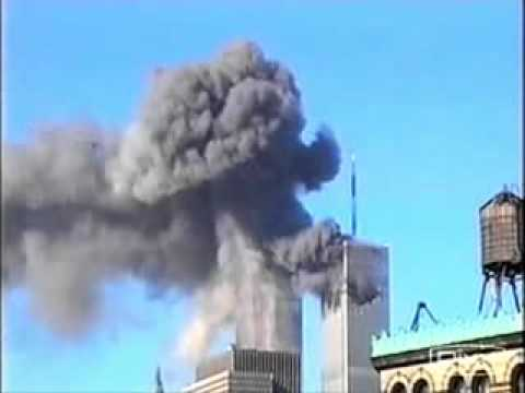 UFO flying over the twin towers burning.flv