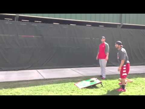 Freese Jay Descalso and Matt Carpenter play cornhole