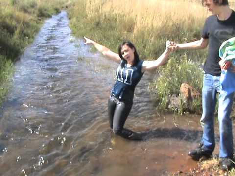 Mel takes a dip in a stream