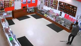 Store owner fights armed thief and takes his gun.
