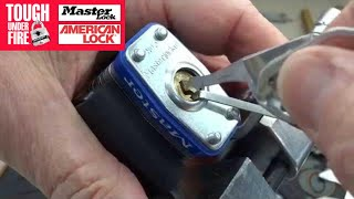 (672) Master Lock Opened w/Cat Food Can Lid