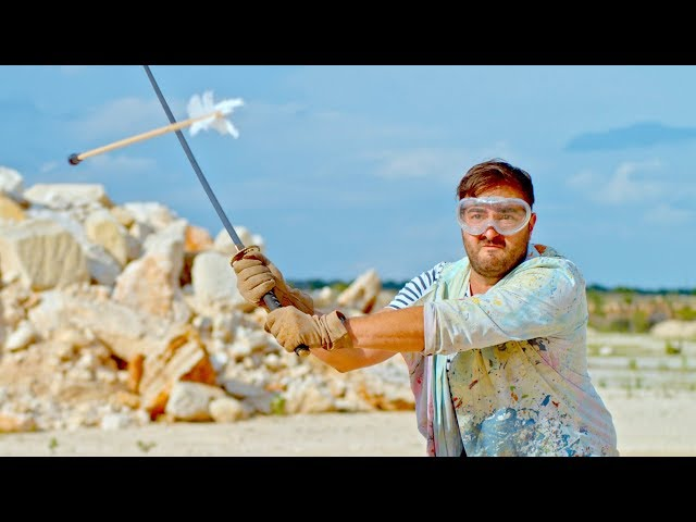 Slicing an Arrow in Half Mid-Air in Slow Motion - The Slow Mo Guys thumbnail