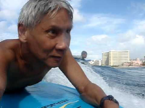 "Slow motion closeup action shots of two skinny teenage boys and myself boogie boarding / bodyboarding at Waikiki ""Walls,"" at the end of Kapahulu Ave. Stand u..."
