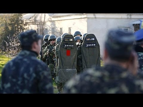 Russian forces storm Ukraine's Crimea airbase