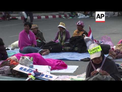 Police checkpoints, security at protest site, after 28 injured in grenade blasts
