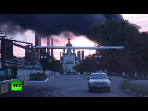 Refinery blazes as heavy shelling hits outskirts of Donetsk