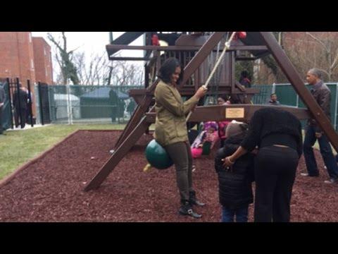 Obamas visit family shelter on MLK Day