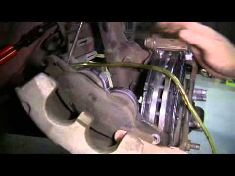 How to Replace the Front Brake Pads and Rotors on a 2004 Ford Mustang LX