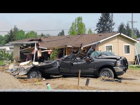 Washington man damages 4 homes in bulldozer rampage, authorities say