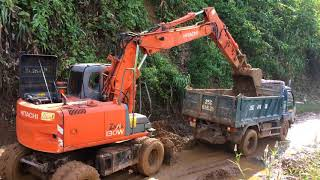 excavator and dump truck video. ô tô máy cẩu xúc đất
