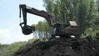 "Old russian excavator EO-5124 loadin"" KamAZ-5111"
