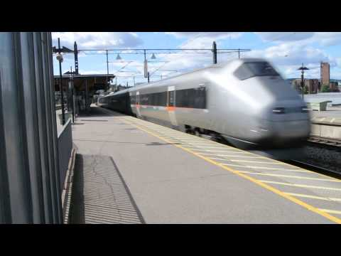 Flytoget (Airport Express Train) passing Lillestrøm station at speed.