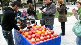 Istanbul street vendor is making Pomegranate Juice for tourists (Turkey 2011)