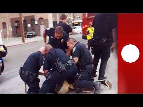 """He's just a kid!"" Onlookers horrified as 9 police arrest teen for jaywalking'"