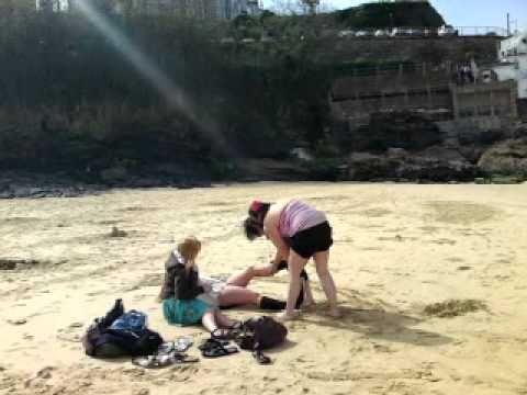 3 Women Strip A Woman On Beach video